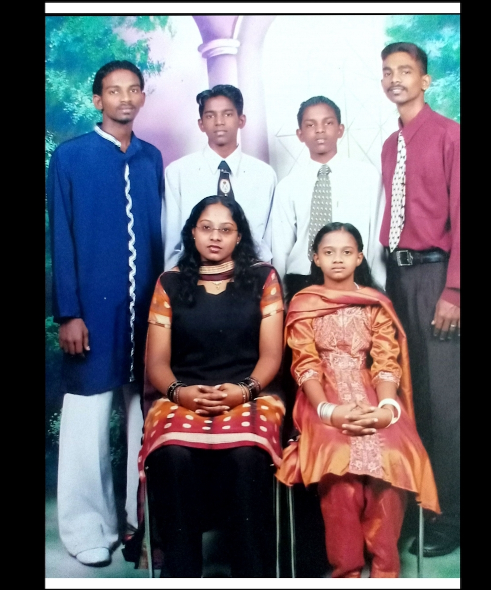 Sangkari (bottom left) made a desperate search for information on the man who had landed her brother Pannir Selvam (in blue) in Singapore's prison. — Picture courtesy of Pannir Selvam's family
