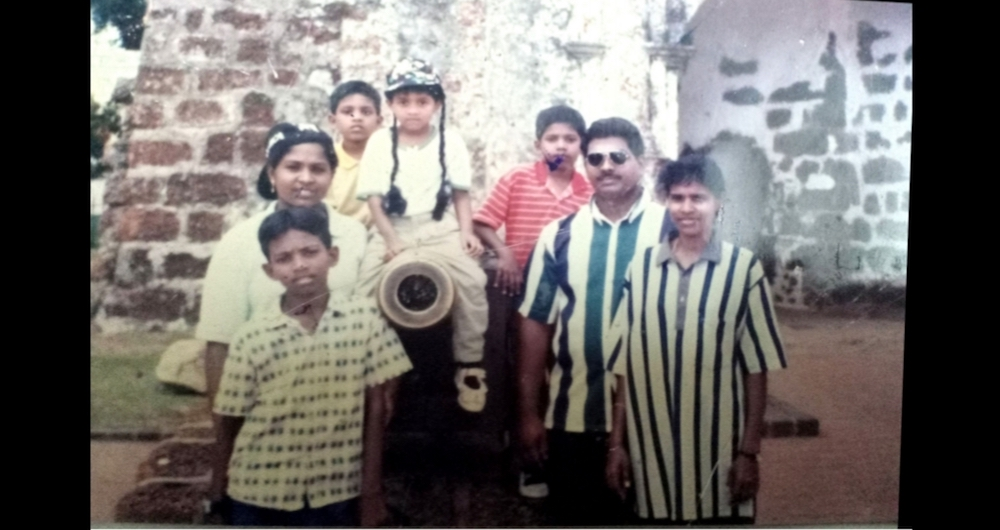 Pannir Selvam (front left), 11, with his family during an outing to Melaka. — Picture courtesy of Pannir Selvam's family