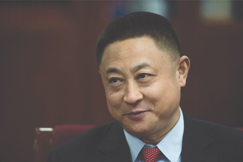 Chinese billionaire Hu Keqin poses in his headquarters in Beijing January 30, 2018. — AFP pic