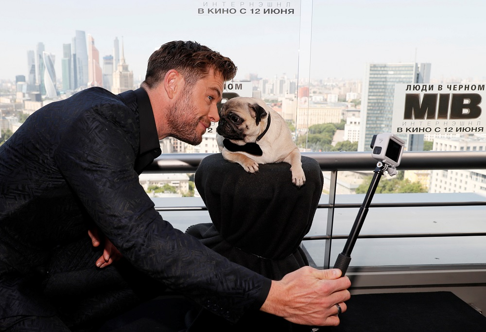 Chris Hemsworth poses for a selfie with a dog during a photocall for the film 'Men in Black: International' ahead of its Russian premiere, in Moscow, Russia June 6, 2019. — Reuters pic