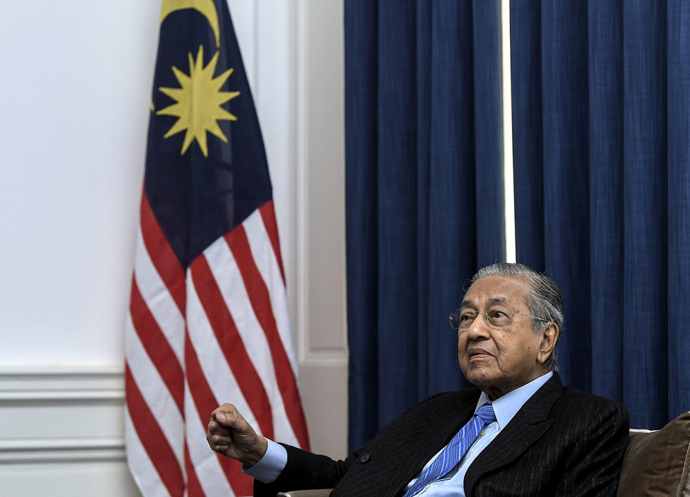 Prime Minister Tun Dr Mahathir Mohamad speaking during a press conferences in conjunction with his three-day visit at the Malaysia High Commission London June 15, 2019. — Bernama pic