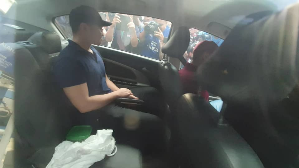 Haziq Abdullah Abdul Aziz pictured leaving the Dang Wangi police station in a car driven by his lawyer June 15, 2019.