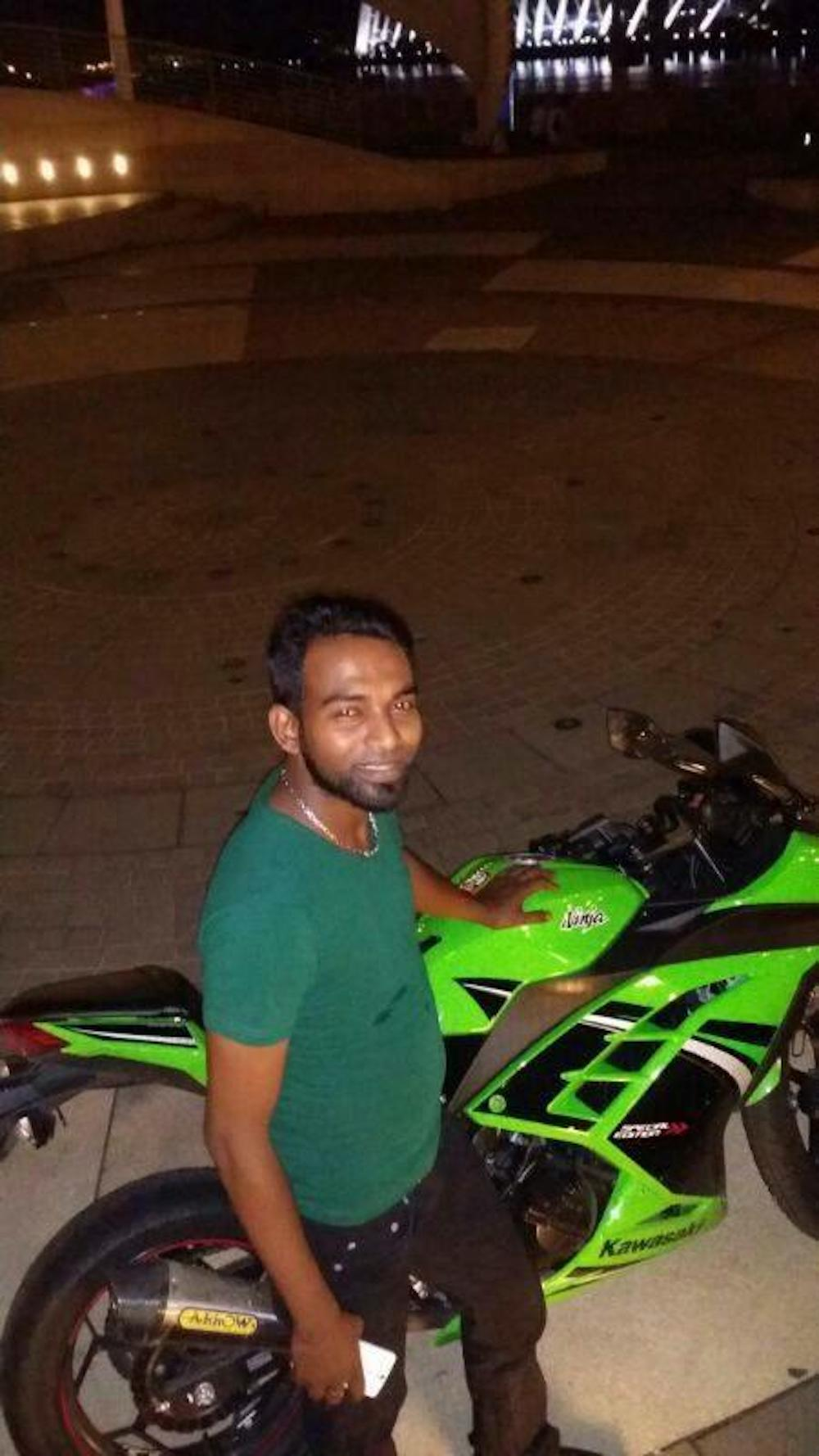 Manchester United fan and motorcycle enthusiast Pannir Selvam is seen here in May 2014 with his newly-purchased motorcycle which he used to visit his elder sister Sangkari. — Picture courtesy of Pannir Selvam's family