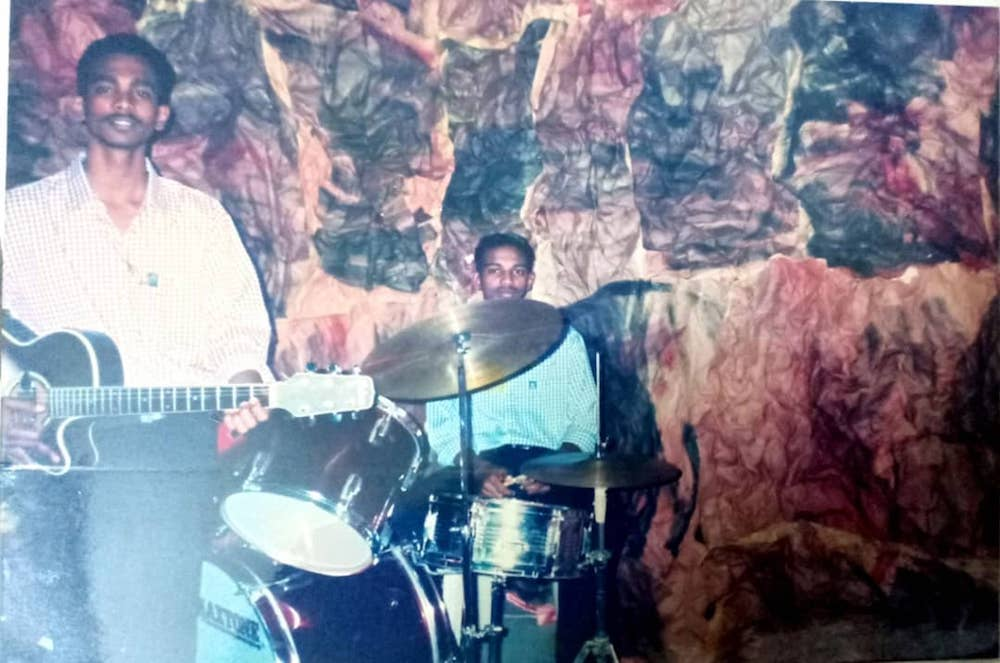 Pannir Selvam, aged 16 or 17, is seen here playing drums in church together with his elder brother Parthiban plays the guitar. — Picture courtesy of Pannir Selvam's family
