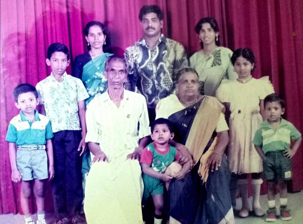 Pannir Selvam (leftmost in blue and white shirt) is seen here in a family photo when he was young. — Picture courtesy of Pannir Selvam's family