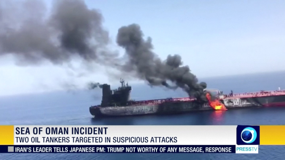Still image taken from a video appears to show two tankers at sea, one of which has a large plume of dark smoke in the Gulf of Oman. — Press TV/IRIB handout pic via Reuters