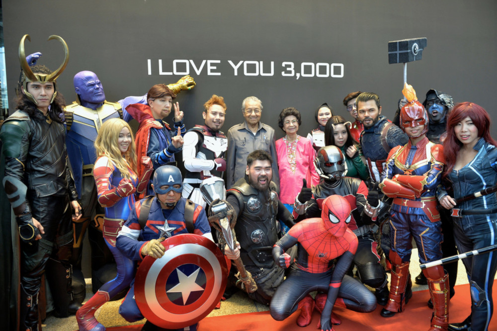 Tun Dr Mahathir Mohamad (centre) poses for a picture with cosplayers during the launch of 'Marvel Studios: Ten Years of Heroes' exhibition at Pavilion, Kuala Lumpur June 27, 2019. — Bernama pic