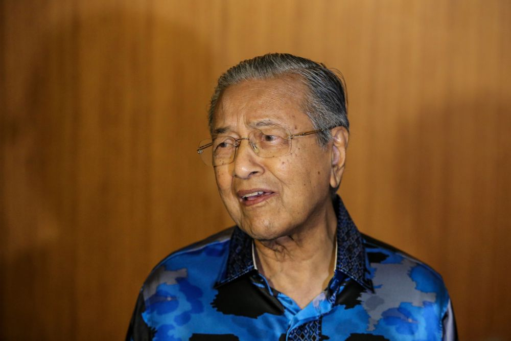 Tun Dr Mahathir Mohamad speaks to reporters during the 'Malam Sejuta Kenangan' event at the Setia City Convention Centre in Setia Alam June 12, 2019. — Picture by Hari Anggara