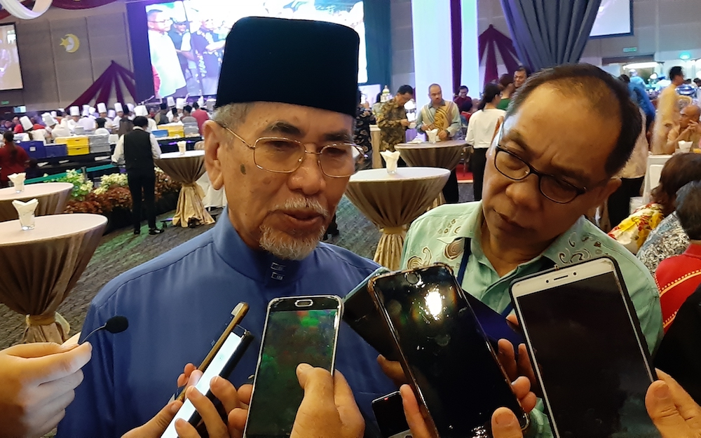 Minister Datuk Seri Wan Junaidi Tuanku Jaafar says the Entrepreneur and Cooperative Development Ministry via the Bank Rakyat agency in Sarawak is finding ways to improve banking facilities in the state including in Sungai Asap and Belaga areas. — Picture by Sulok Tawie