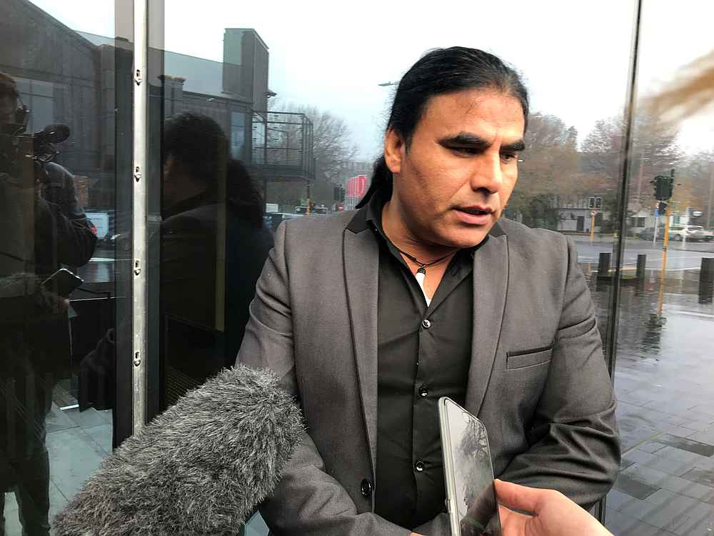 Abdul Aziz, who chased away gunman Brenton Tarrant with an Eftpos machine at Linwood mosque on March 15, speaks to journalists outside the Christchurch High Court in Christchurch, New Zealand June 14, 2019. — Reuters pic