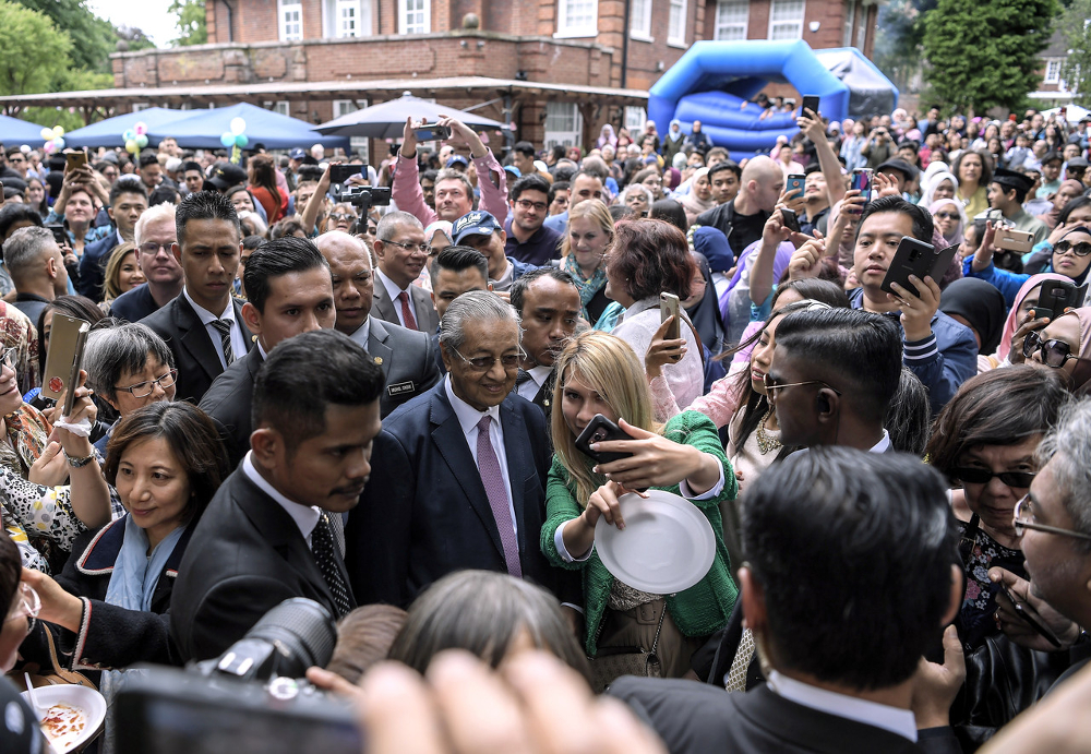 Prime Minister Tun Dr Mahathir Mohamad having a light moment with visitors during Hari Raya Eid Open House at Residence of the Malaysian High Commissioner House in London June 16, 2019. — Bernama pic
