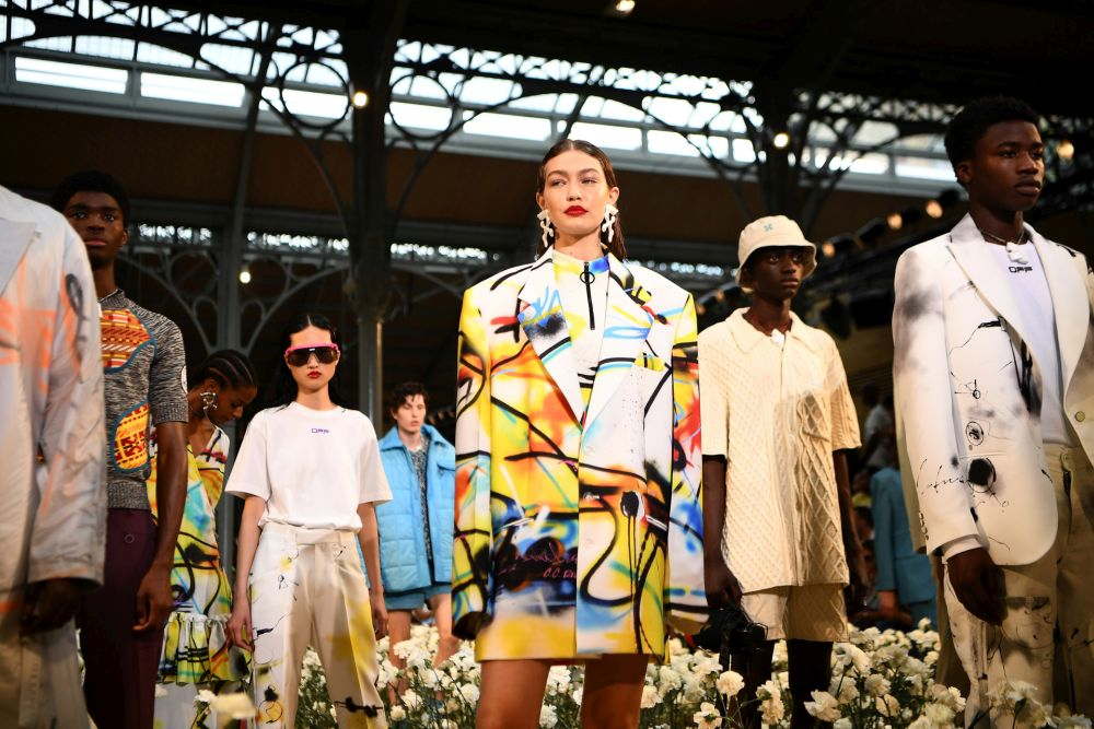 US model Gigi Hadid (centre) and models present creations by Off-White during the men's Spring/Summer 2020 collection fashion show on June 19, 2019 in Paris. — AFP pic