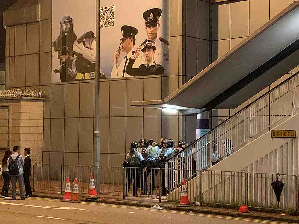 Riot police stand near a staircase during a demonstration against a proposed extradition bill in Hong Kong June 12, 2019. — Twitter@HongKongHermit image via Reuters