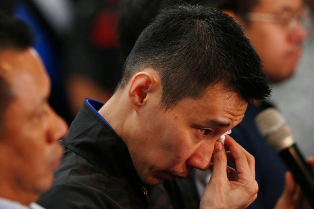 Datuk Lee Chong Wei wipes away tears during a news conference to announce his retirement in Putrajaya June 13, 2019. — Reuters pic
