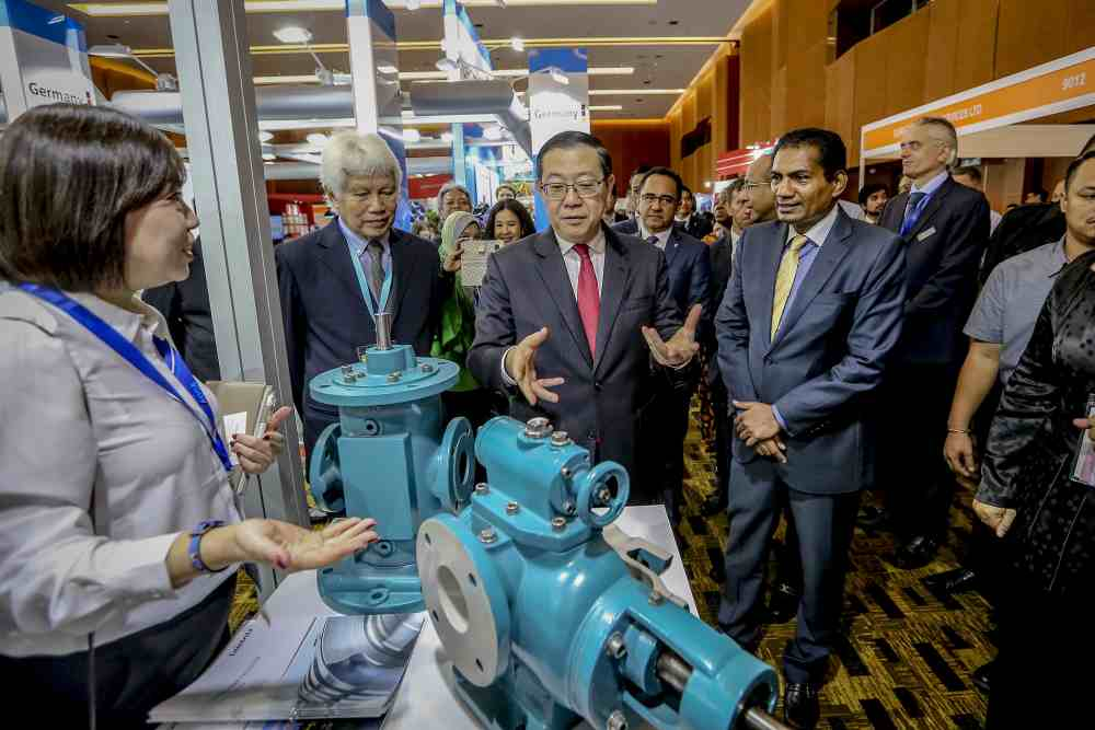 Finance Minister Lim Guan Eng visits a booth after launching the 17th Asian Oil, Gas and Petrochemical Engineering 2019 Exhibition in Kuala Lumpur June 18, 2019. ― Picture by Firdaus Latif