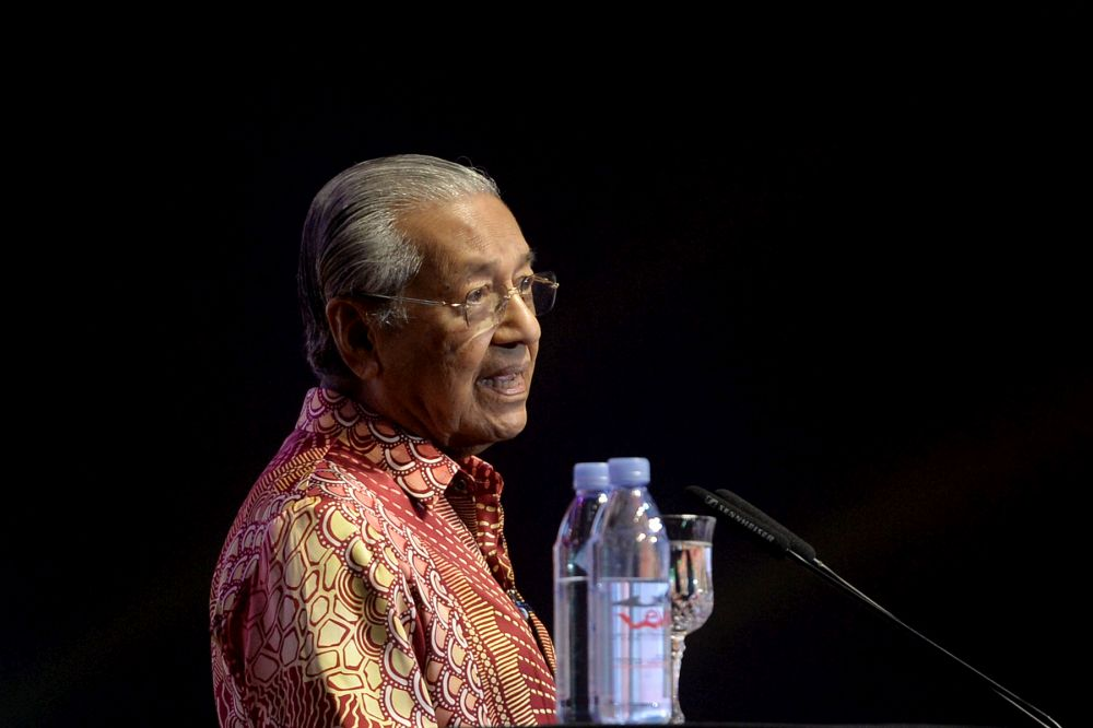 Tun Dr Mahathir Mohamad confirmed today that the government will table a motion in Parliament next month to compel all lawmakers to declare their assets. — Picture by Mukhriz Hazim