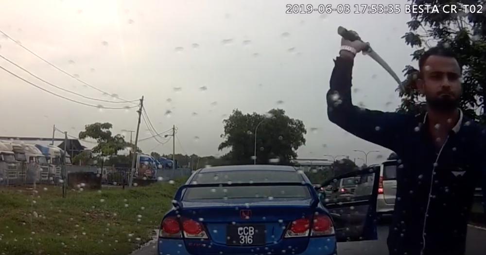 A screengrab from YouTube of a man attacking a car with a parang along the Pasir Gudang Highway June 3, 2019.