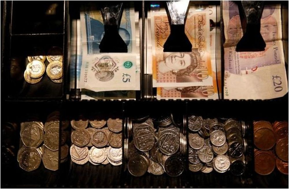 Pound Sterling notes and change are seen inside a cash register in a coffee shop in Manchester, Britain, September 21, 2018. — Reuters pic