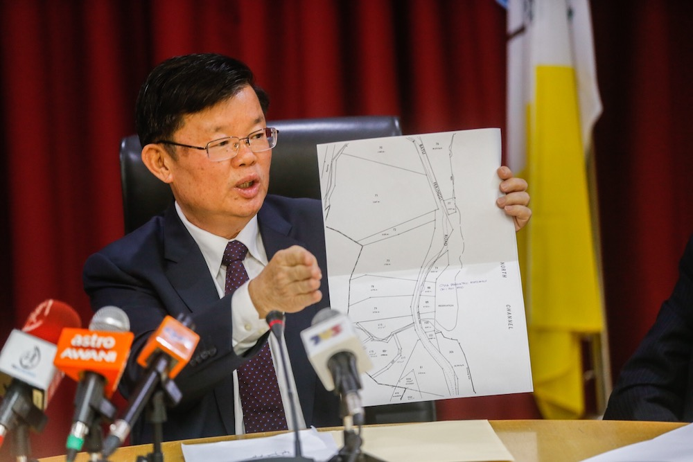Penang Chief Minister Chow Kon Yeow shows the sitemap of the landslide in Tanjung Bungah during a press conference in George Town June 26, 2019. — Picture by Sayuti Zainudin