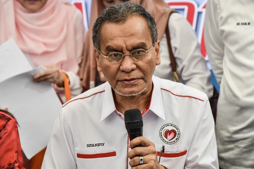 Health Minister Datuk Seri Dzulkefly Ahmad speaks to the media after launching an operation to release Wolbachia-infected mosquitoes at the Sri Rakyat apartment in Bukit Jalil, July 7, 2019. — Picture by Hari Anggara