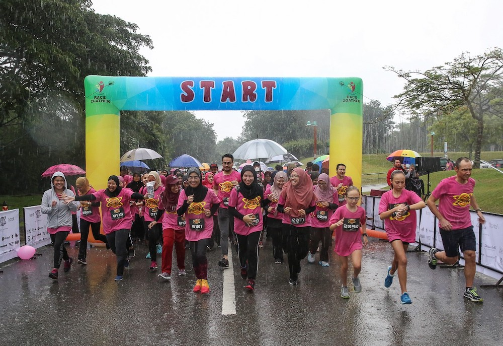 The early morning downpour failed to dampen the spirit of Venus Fun Run participants. — Picture by Mohd Yusof Mat Isa
