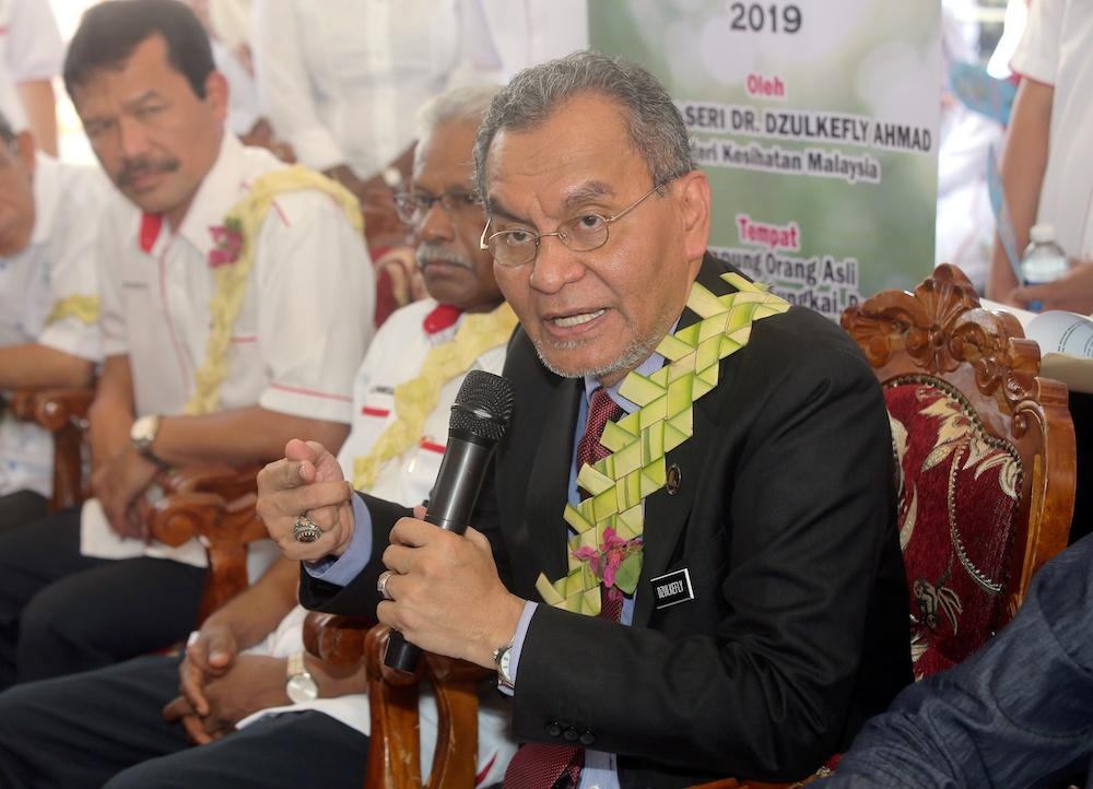 Health Minister Datuk Seri Dzulkefly Ahmad at the launch of the Orang Asli teeth icon programme at Kampung Orang Asli Menderang 1 in Sungkai July 11, 2019. — Picture by Farhan Najib