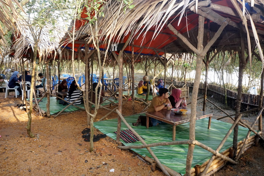 The unique experience of dining under a canopy of api-api trees has  been drawing many visitors to an eatery by the beach in Kuala Tebengau, Kuala Kedah. — Bernama pic