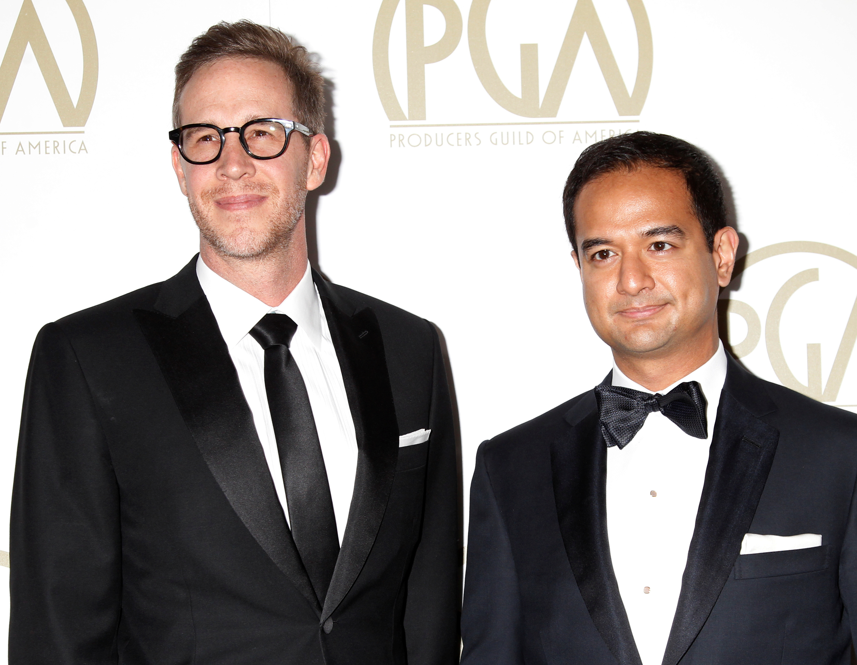 Riza Aziz stands with Joey McFarland, another producer of the film 'The Wolf of Wall Street', as they arrive at the 25th Annual Producers Guild of America Awards in Los Angeles January 19, 2014. — Reuters pic