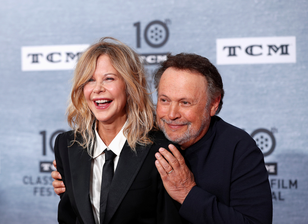 Cast members Billy Crystal and Meg Ryan pose as they arrive for the 30th anniversary screening of comedy movie 'When Harry Met Sally' in Los Angeles April 11, 2019. — Reuters pic