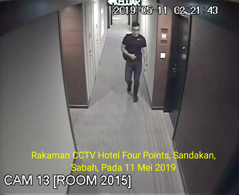 The clip, just under four minutes, purportedly shows the footage taken at the elevator banks at the Four Points by Sheraton Hotel in Sandakan, with the timestamp showing the early hours of May 11.