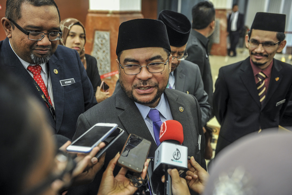 Minister in the Prime Minister's Department Datuk Seri Mujahid Yusof Rawa speaks during a press conference at the lobby of Parliament in Kuala Lumpur July 9, 2019. — Picture by FIrdaus Latif