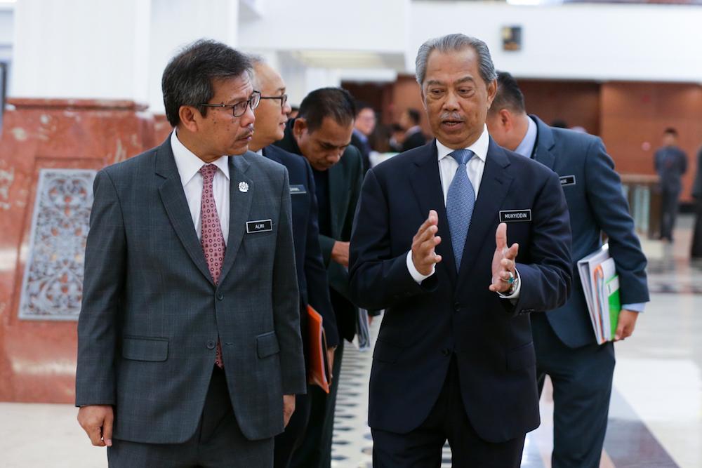 Tan Sri Muhyiddin Yassin arrives at the Parliament building in Kuala Lumpur July 10, 2019. — Picture by Ahmad Zamzahuri