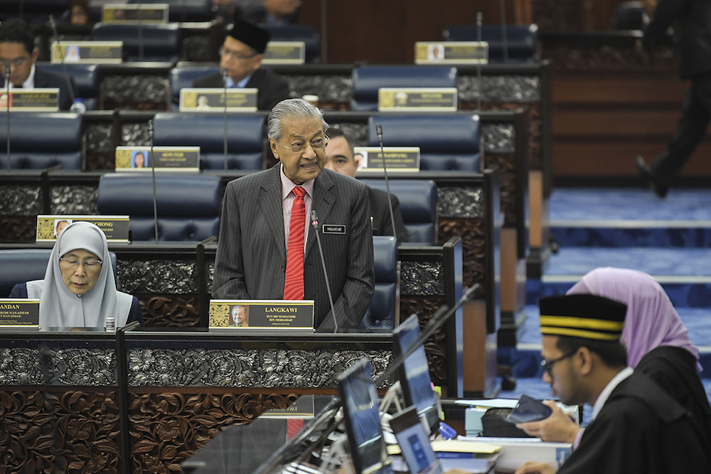 Tun Dr Mahathir Mohamad made a final plea across the aisle for the supermajority necessary to amend the Federal Constitution to allow youths aged 18 and over to stand for elections. — Picture by Miera Zulyana