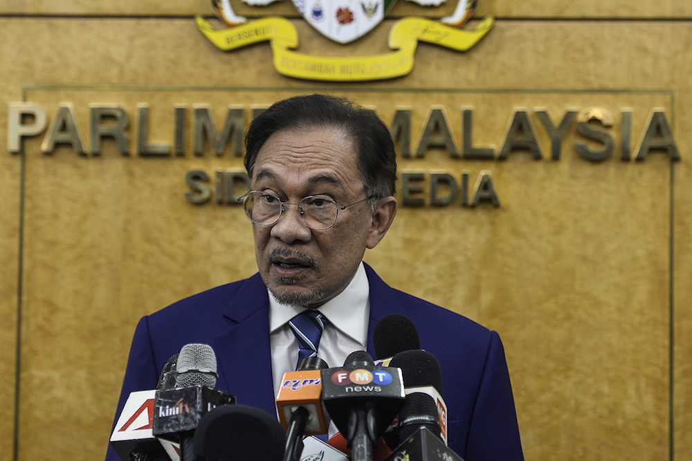 Port Dickson MP Datuk Seri Anwar Ibrahim speaks to reporters in Parliament July 16, 2019. — Picture by Miera Zulyana