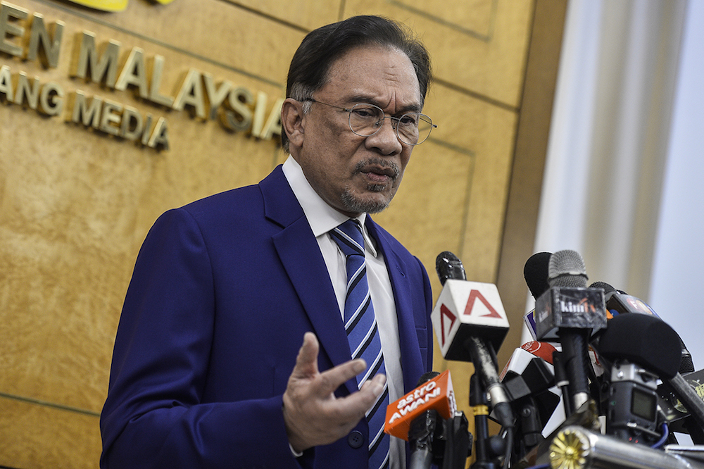 Datuk Seri Anwar Ibrahim says the Home Affairs Ministry must act upon Muslim preacher Wan Ji Wan Hussin's allegation that he was assaulted by a warden at the Kajang Prison. — Picture by Miera Zulyana