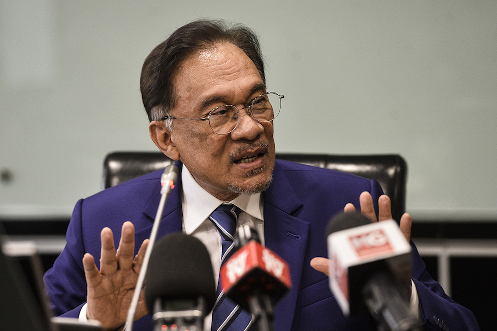 Datuk Seri Anwar Ibrahim says Public Accounts Committee deputy chairman Wong Kah Woh's selection to lead the Sustainable Energy Development Authority is permissible as it is not a GLC. — Picture by Miera Zulyana