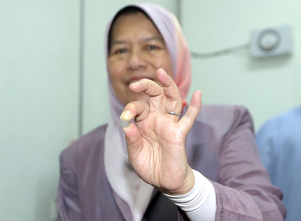Housing and Local Government Minister Zuraida Kamaruddin holds a PEF pellet during a visit to alternative fuel manufacturer ResourceCo Asia in Chemor July 17, 2019. — Picture by Farhan Najib