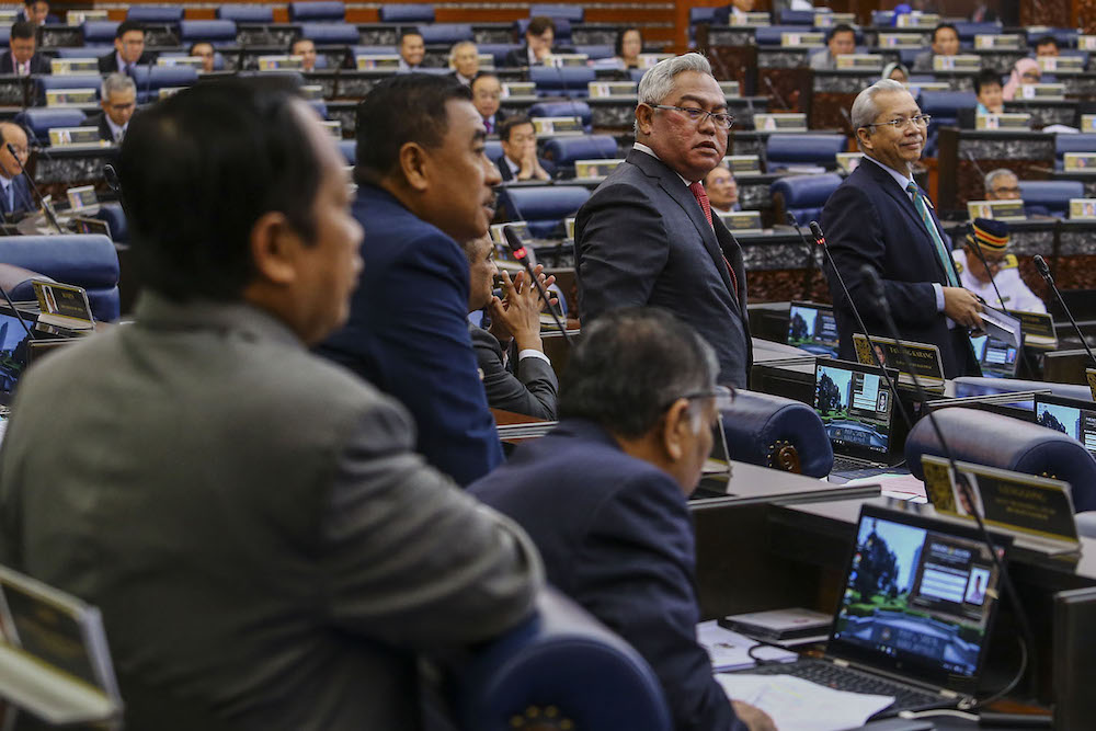 Members of the Opposition stage a walkout at the Dewan Rakyat in Kuala Lumpur July 17, 2019. — Picture by Hari Anggara