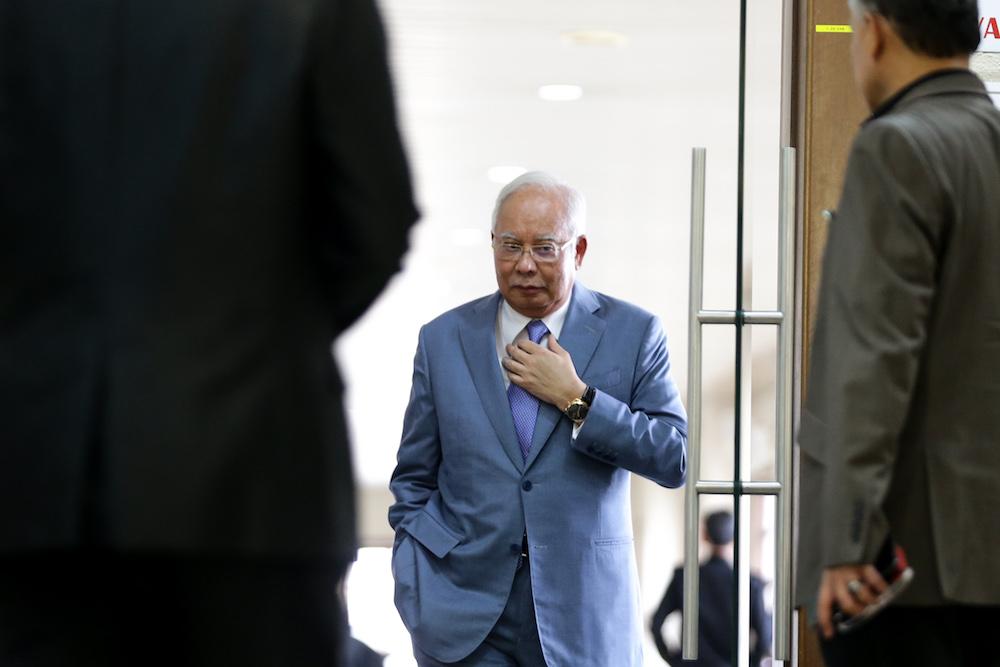 Datuk Seri Najib Razak is seen at the Kuala Lumpur Courts Complex July 18, 2019. — Picture by Ahmad Zamzahuri
