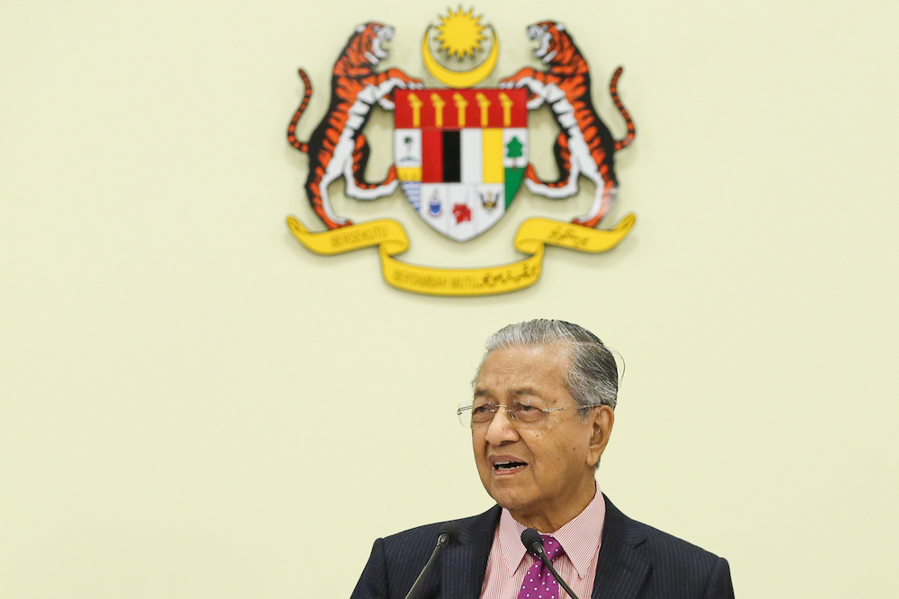 Prime Minister Tun Dr Mahathir Mohamad said that Pakatan Harapan took over a huge financial problem due to the excessive loans taken up by the previous Barisan Nasional government. — Picture by Yusof Mat Isa
