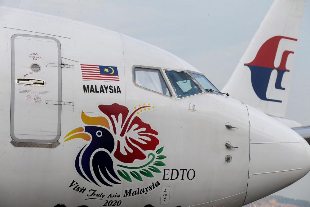 The Visit Malaysia Year 2020 logo is seen on an aircraft at the Bunga Raya Complex, Sepang July 22, 2019. — Picture by Ahmad Zamzahuri