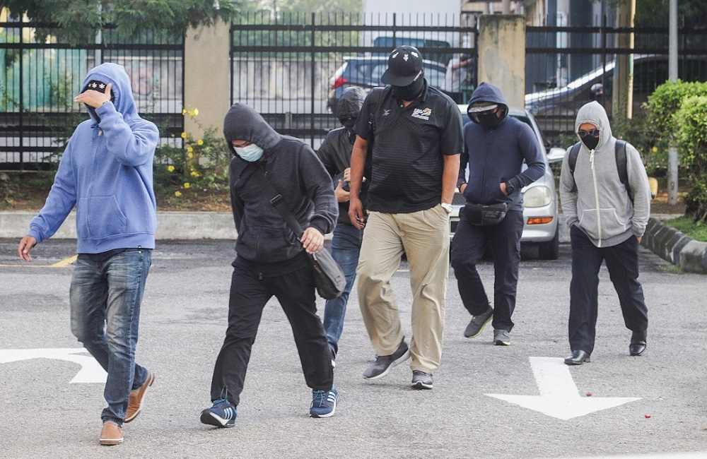 The five RTD and one SPAD enforcement officers arriving at the Sessions Court in Butterworth July 24, 2019. — Picture by Sayuti Zainudin