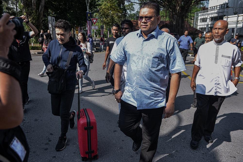 Umno Supreme Council member Datuk Lokman Noor Adam arrives at the Bukit Aman Police headquarters in Kuala Lumpur July 26, 2019. — Pictures by Mukhriz Hazim