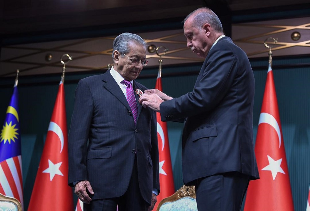 Tun Dr Mahathir Mohamad conferred the Order of the Republic by Turkish President Recep Tayyip Erdogan during a joint press conference at the Presidential Complex in Ankara July 25, 2019. — Bernama pic