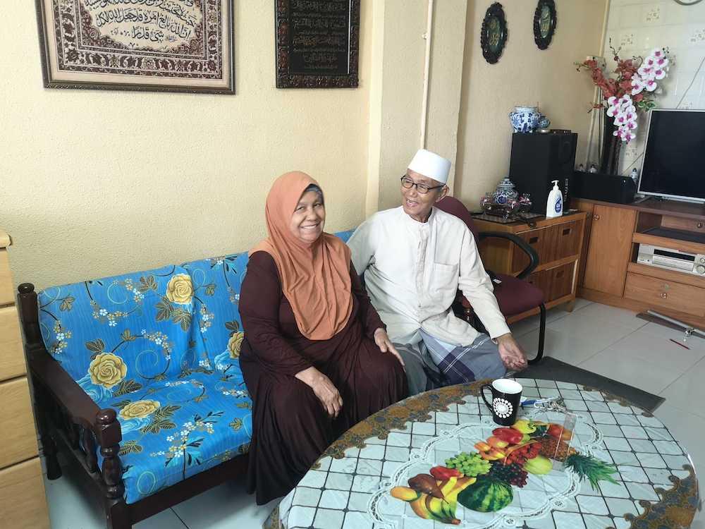 Ahmad Basar, who has dedicated half his life to taking care of the surau, and his wife Sofipiaton Hj Tayib, 73. — Picture by Nabilah Awang via TODAY