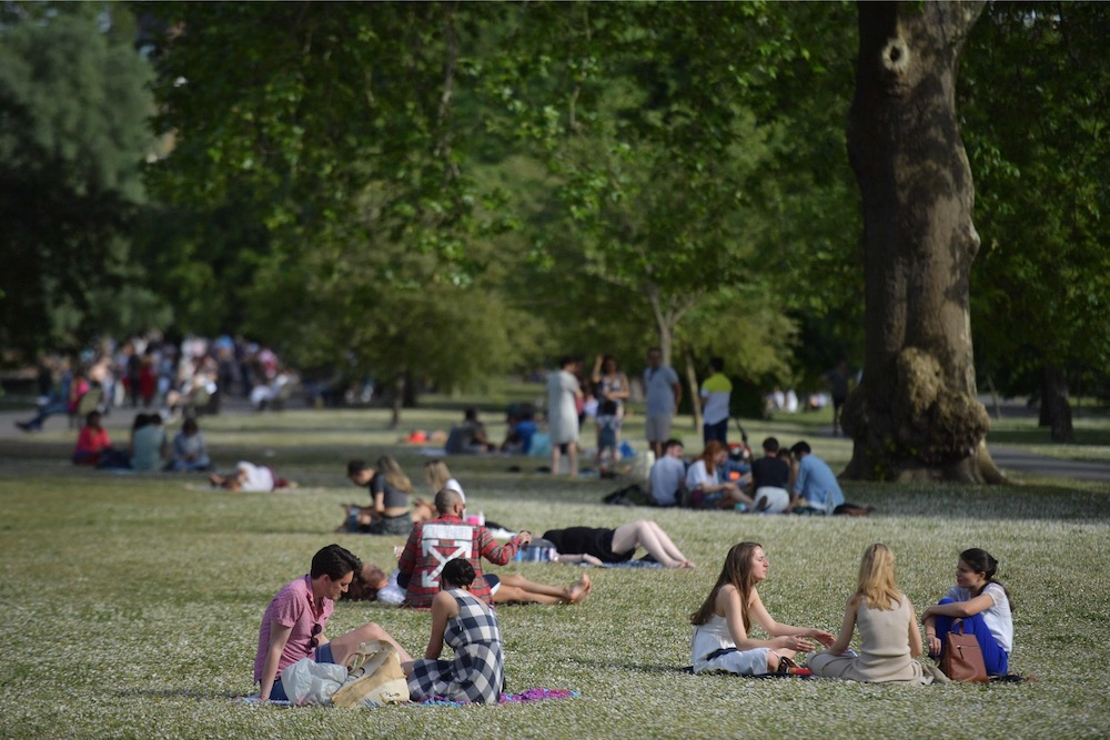 People relax in the warm weather in Regents Park in London on June 1, 2019. — AFP pic