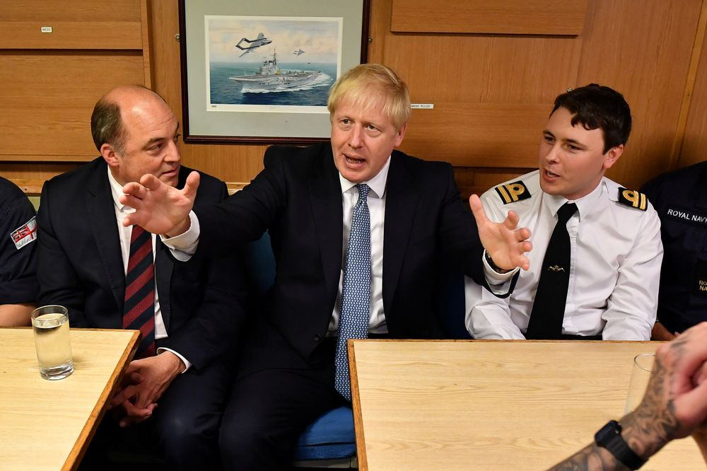 Britain's Prime Minister Boris Johnson and Defence Secretary Ben Wallace meet crew members in the mess hall as they visit HMS Victorious at HM Naval Base Clyde in Faslane, Scotland, Britain July 29, 2019. — Reuters pic