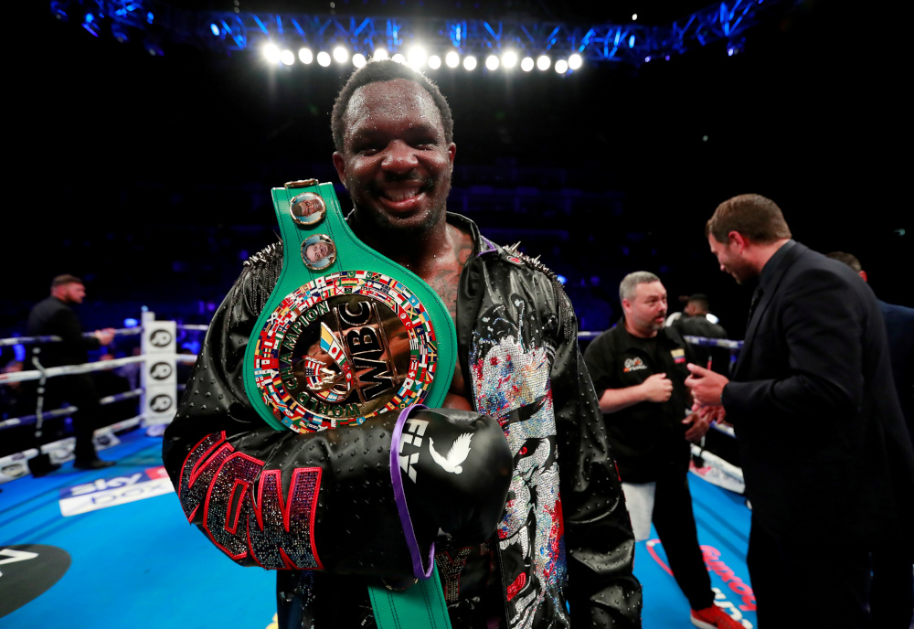 Dillian Whyte celebrates winning the fight against Oscar Rivas for the WBC Interim World Heavyweight Title at the 02 Arena, London, Britain, July 20, 2019. — Action Images via Reuters
