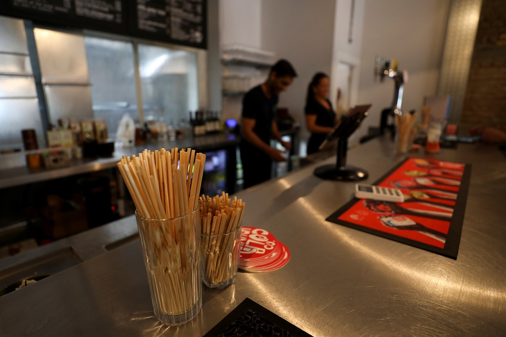 Wheat straws sit on the bar at the Green Vic, a pub in London aiming to be the world's most ethical pub, in the Shoreditch, London July 5, 2019. — Reuters pic