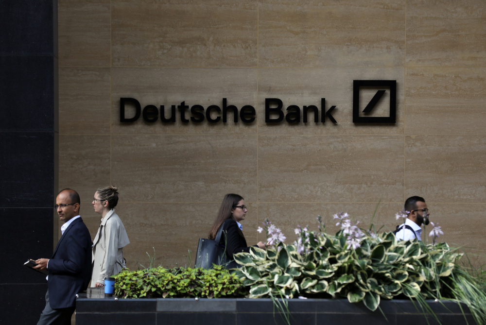 People walk past a Deutsche Bank office in London, Britain July 8, 2019. — Reuters pic